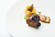 black pudding on a white plate in a restaurant - 213473062