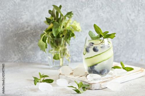 Foto Murales Cold Infused Water with Cucumber and Blueberry. Trend Summer Iced Drinks. Season Beverages.
