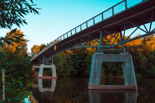 Aluminium Bruggen pedestrian bridge across the river