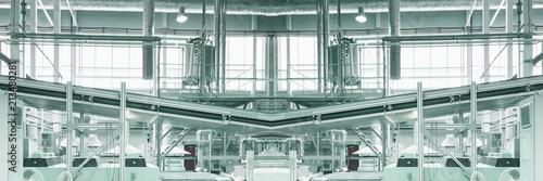 Slightly blurred toned and defocused industrial collage background - pipes, feed line, supports, equipment, machinery. Wide panoramic image.