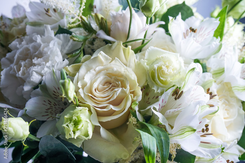 beautiful wedding bouquet with white roses and other flowers on wooden background  with 2 wooden pigeons
