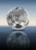 Tajikistan on translucent globe above water