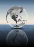Cambodia on translucent globe above water