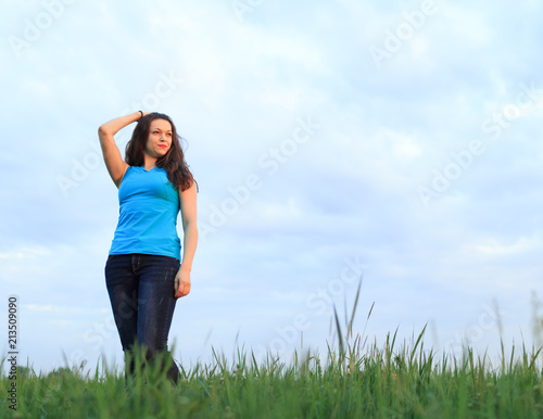 Young woman against the sky