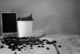 coffee beans and cup on the wooden table. - 213515282