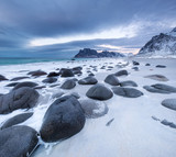 Seashore with stones during sunset. Beautiful natural seascape in the Norway - 213523824