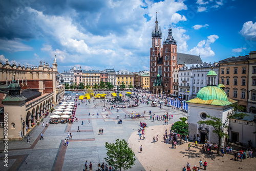 Cracow (Krakow) - Main Square (Rynek Glowny) with Marketplace (Sukiennice), Adam Mickiewicz Monument, church of Saint Mary (Kosciol Mariacki) and church of Saint Adalbert - window view