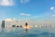 Leinwanddruck Bild - Female Tourist In Infinity Pool Of Marina Bay Singapore