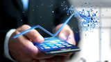 Businessman using a smartphone with a  Financial arrow going up and explosing at the end - 3d rendering - 213527240