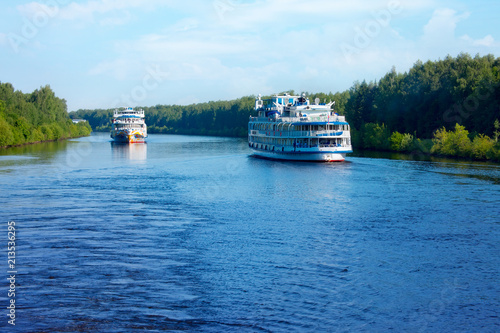 Foto Murales Landscape with  cruise passenger ships on the canal of Moscow in a summer morning