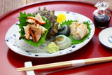 sazae ( horned turban shell ) sashimi, traditional japanese seafood dish - 213542008