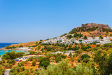 Sea skyview landscape photo Lindos bay and castle on Rhodes island, Dodecanese, Greece. Panorama with ancient castle and clear blue water. Famous tourist destination in South Europe - 213547263