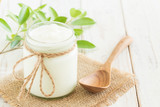 Yogurt in glass bottles on white wooden table Healthy food concept - 213558211