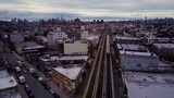 Elevated over train on tracks city horizon - 213562487