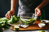 Man cooking green detox salad romaine lettuce Healthy food - 213572240