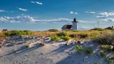 Lighthouse Point on beach dunes, Race Point Light Lighthouse in Cape Code, New England, Massachusetts, USA. - 213579428