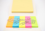 Paperclips with colorful notepads. Office and school equipment. - 213581469