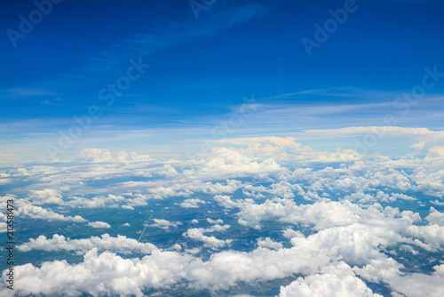 Beautiful view of blue sky above the white clouds from airplane window - 213581473