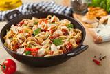 Whole-grain tagliatelle pasta with grilled chicken. - 213582293