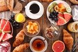 coffee with fruit, cereal and croissant