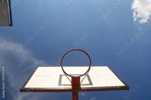 Fotobehang Basketbal Red Basketball hoop on sky background