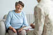 Elderly woman talking with financial advisor about loan during appointment