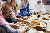 Muslim family having dinner on the floor - 213599450