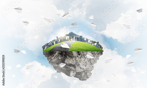 Poster Modern cityscape with towers and skyscrapers on green part of land
