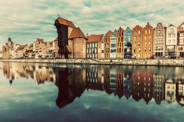 Old buildings and Zuraw crane near Motlawa river in Gdansk