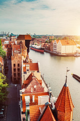 Antique building and river Motlawa in Gdansk