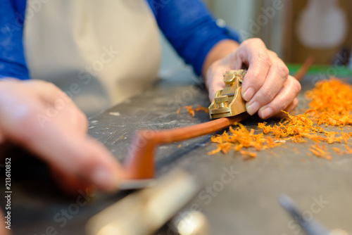 carving a bow - 213610852