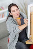 woman on her painting hobby - 213617208