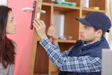 man fixing the door with screwdriver - 213619895