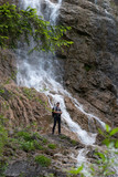 waterfall on the forest with person