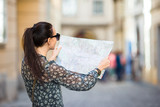 Young woman with a city map in city. Travel tourist girl with map in Vienna outdoors during holidays in Europe. - 213631286