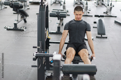 Fototapeta Asian man exercising in the gym,