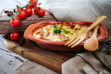 French Tartiflette Recipe Bacon, Potato and Reblochon Cheese Gratin - 213651831