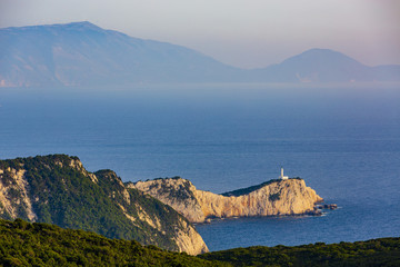 Sunset view with magical lighthouse over Cape of Doukato, Lefkada island in Ionian Sea, Lefkas, Greece