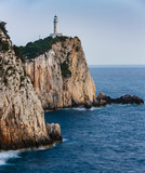 Sunset view with magical lighthouse over Cape of Doukato,  Lefkada island in Ionian Sea, Lefkas, Greece - 213653494