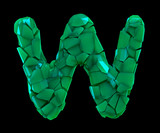 Capital letter W made of broken plastic green color isolated on black background - 213662854
