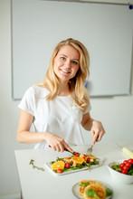 "Постер, картина, фотообои ""young nice girl eting salad with knife and fork. mother"