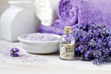 Lavender flowers, aromatic sea salt and towels. Concept for spa, beauty and health salon, cosmetics store. Close up photo on white wooden background. - 213668692