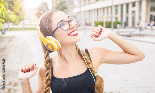 Music teenager girl dancing with headhphone