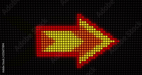 Big illuminated arrow sign built of light bulbs LED. Neon yellow arrow symbol seamless and loopable animation.