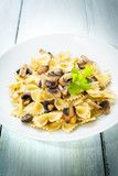 Piatto di farfalle ai funghi trifolati, Italian food - 213680813