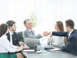 businessman and investor shake hands at the negotiating table - 213691235