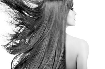 Beauty model with gorgeous long hair blowing to the side