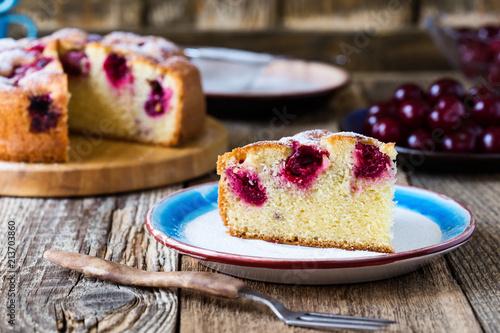 Fotobehang Kersen Slice of cherry cake and fresh summer berries on rustic table