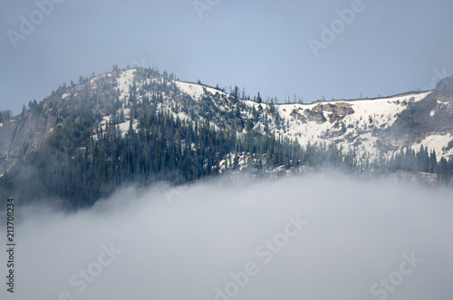 Snowy Mountain Peaks Standing Above the Clouds