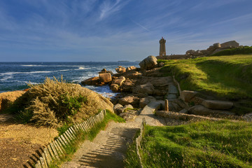 Lighthouse among the red rocks of Perros-Guirec, France © janmiko